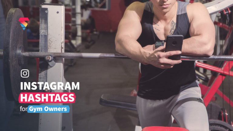 instagram hashtags gym owner on phone in gym