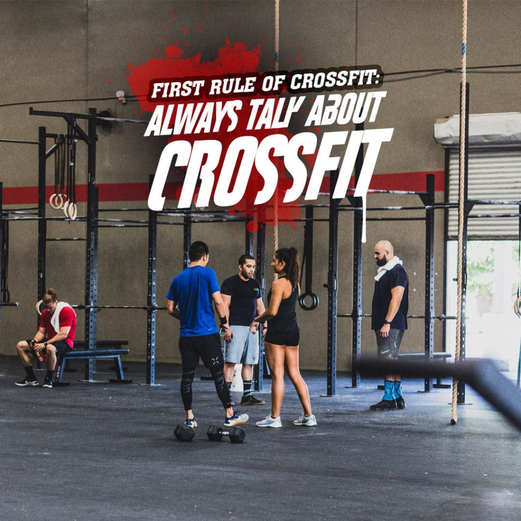 group of crossfitters talking with crossfit quote